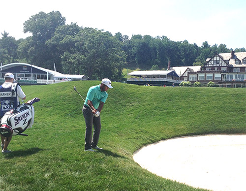 Harold Varner in bunker on the par 5, 18th hole, during Thursday's opening round.