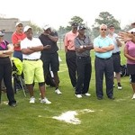 Champions Tour Pro golfer Jim Thorpe humors participants while teaching the golf clinic