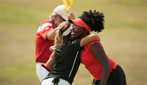 Ireanna Pette of Delaware State University hugs Sofia Alvarez of North Carolina A&T University after their match on the Ryder course during First Round at the 2017 PGA Minority Collegiate Golf Championship held at PGA Golf Club on May 12, 2017 in Port St. Lucie, Florida. (Photo by Montana Pritchard/PGA of America)
