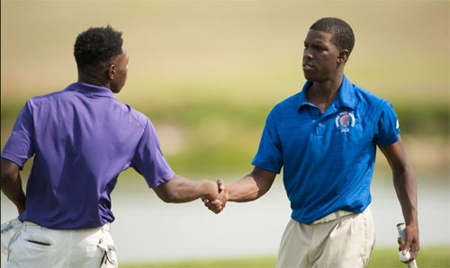 MAY 12: Isaiah Belton of Virginia State University shakes hands with Cameron Wilhite of Miles College after their round on the Wanamaker course during First Round at the 2017 PGA Minority Collegiate Golf Championship held at PGA Golf Club on May 12, 2017 in Port St. Lucie, Florida. (Photo by Montana Pritchard/PGA of America) Credit: PGA