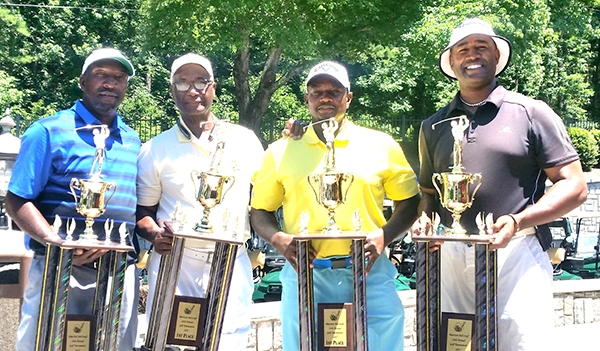 President Karon Graves and his team with the third of  three of his first place finishes at the 24th Annual Marriott Tournament. Players from left to right. Charles Woods, Karon Graves, Vince Miller and Kip Redo.