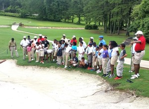 Kids observing instruction  about bunker play with Instructor Isiac Dukes.