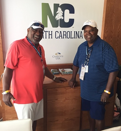 (L-R) Ronnie L. Bryant, President/CEO, Charlotte Regional Partnership with James R Beatty, AAGD, Executive Editor and President NCS International chat in the Corporate Tent.