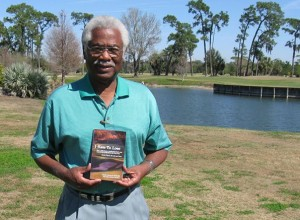 "Charlie Owens, the retired head pro at Tampa's Rogers Park, holds a copy of his book, ""I Hate To Lose,"" confronted racism, injustice and pain on and off the golf course."