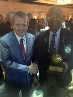 L-R: Former PGA Tour Commissioner Timothy W. Finchem congratulates Billy Brent.