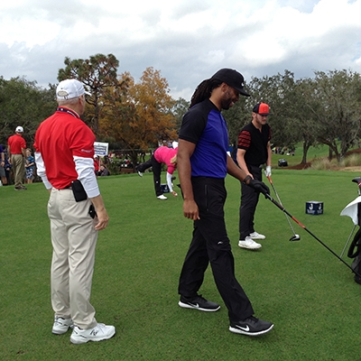 Arizona Cardinal's ace Wide Receiver Larry Fitzgerald on the tee with playing partners Josh Donaldson and Brittany Lincicome.